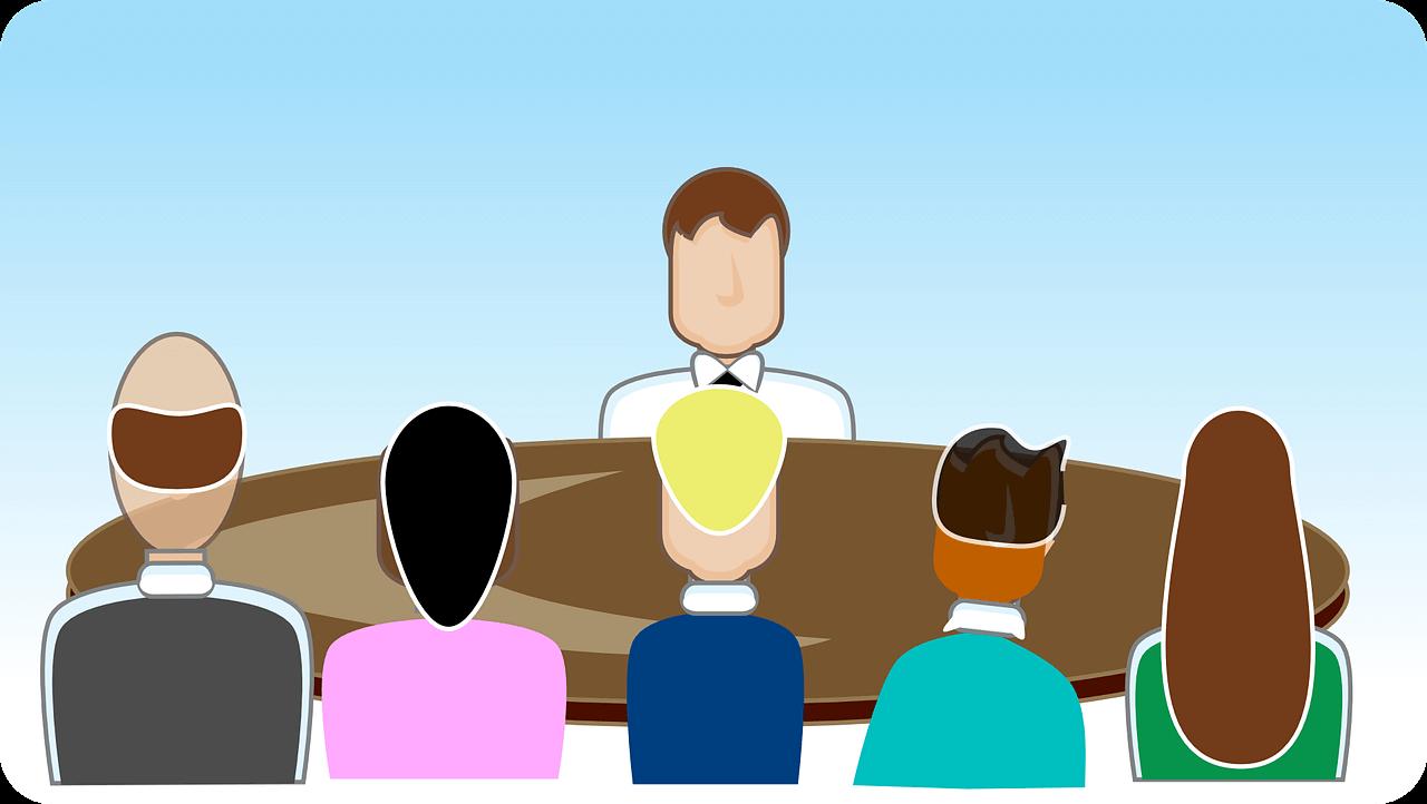 Manager am Tisch mit Mitarbeitern im Comic-Stil.