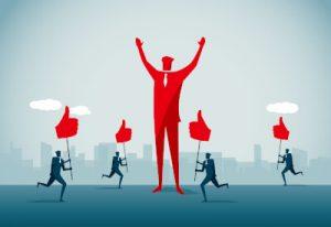 Manager wird von anderen für seine gute Arbeit bejubelt